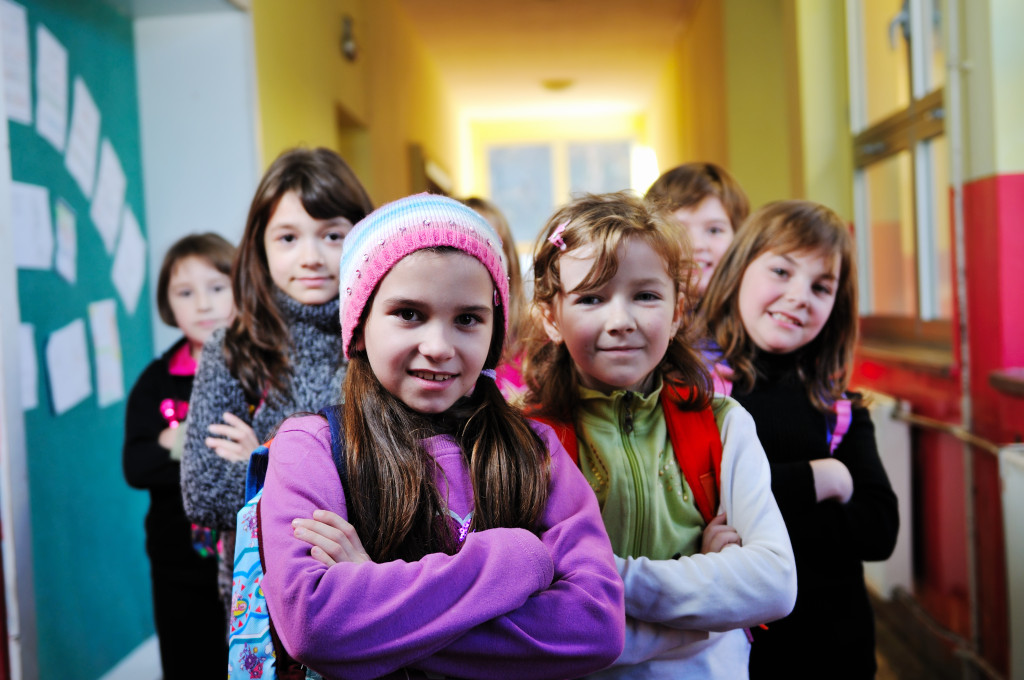 happy children group in school The Link Between ADHD And Addiction